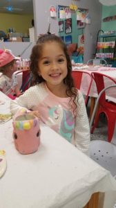 girl with unicorn mug pottery painting